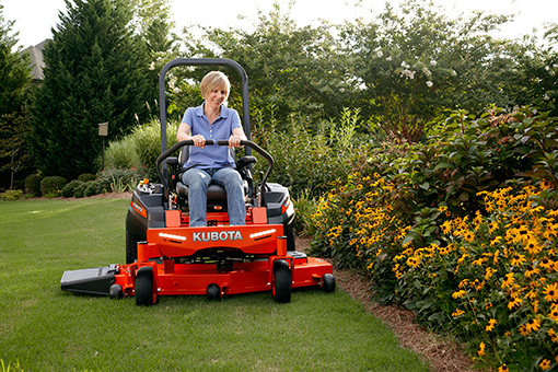 Kubota zero turn mower with lady on