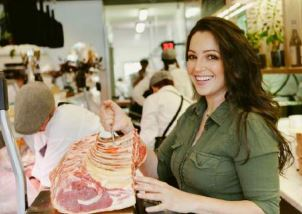 Jess Pryles looking at meat