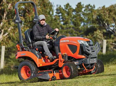 Kubota compact tractor mowing