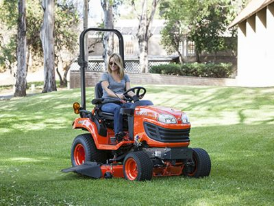 Compact tractor mowing small tractor
