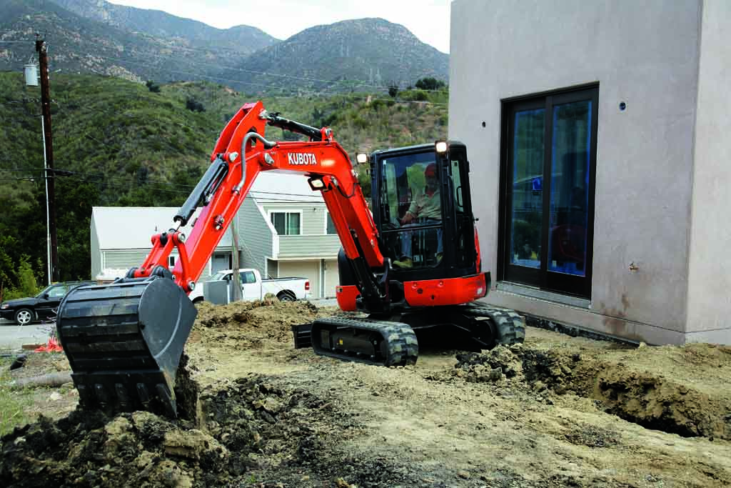 Kubota KX040 model using digger