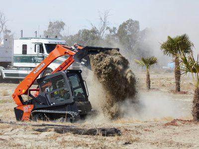 Kubota SVL75 dumping dirt