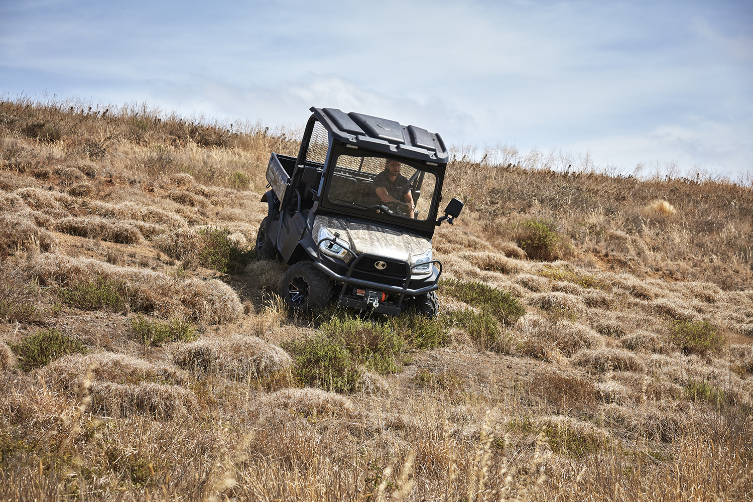 Kubota RTV camo model tough driving down hill